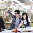 Cheerful students at library — Stock Photo