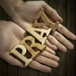 Man holding pray word in palm — Stock Photo #41887177