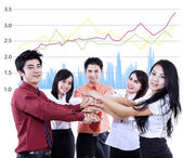 Business team overlapping hands — Stock Photo