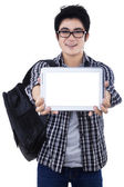 Male student showing copyspace on digital tablet — Zdjęcie stockowe