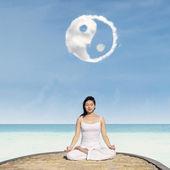 Yoga under Yin Yang cloud — Stock Photo