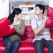 Stock Photo: Angry couple on red sofat home