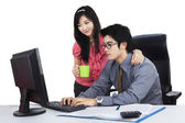 Businessman with his secretary working — Stock Photo