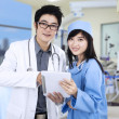 Stock Photo: Young medical team at hospital