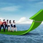 Businessteam pulling arrow upward — Foto Stock