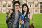 Attractive students expressing success outdoor — Stock Photo