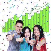Young people giving thumbs up — Stock Photo