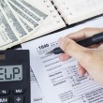 Businessman filling tax form — Stock Photo #43256469