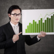 Businessman with chart of profits — Stock Photo