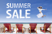 Beach chairs and girl jumping for summer sale — Stok fotoğraf