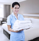 Cleaning lady at hotel room — Stockfoto