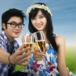 Young couple enjoying champagne outdoor — Stock Photo