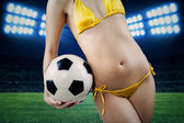 Sexy body and soccer ball — Stock Photo