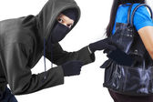 Thief stealing cell phone — Stock Photo
