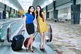 Two woman in airport — Stock Photo