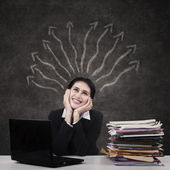 Businesswoman with many business inspirations — Stock Photo
