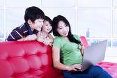 Asian family browsing the internet — ストック写真