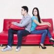 Couple sitting back to back after a fight — Foto Stock