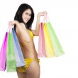 Sexy woman holding shopping bags isolated — Stock fotografie