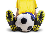 Football player sitting with ball isolated — Stock Photo