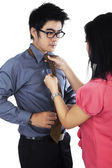 Man dressing up by help his assistant — Stock Photo