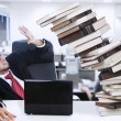 Stress businessman and falling books at office — Photo