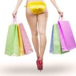 Woman long legs holding shopping bags — Foto de Stock