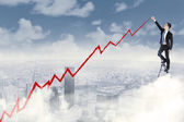 Success businessman drawing a positive graph — Stock Photo