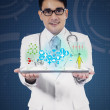 Male doctor holding tablet pc — Stock Photo