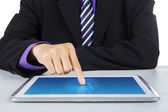 Businessman touching the digital tablet screen — Stock Photo