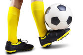 Foot playing soccer ball — Stock Photo
