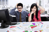 Stressed businessteam analyzing business chart — Stock Photo