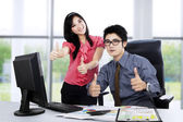 Boss and secretary showing thumbs up — Stock Photo