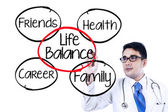 Doctor making life balance concept — Stock Photo
