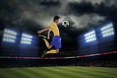 Football player controlling ball — Stock Photo
