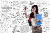 Smart student writes formula — Stock Photo