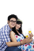 Young couple with glasses of champagne — Stock Photo