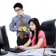 Boss with employee working together — Stock Photo