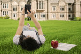 A student using smarpthone outdoor — Stock Photo