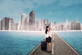 Businesswoman and modern city — Stock Photo