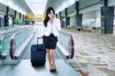 Businesswoman making a phone call at airport — Stock Photo