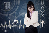 Female doctor with medical background 1 — Stock Photo