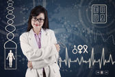 Female doctor with medical background — Stock Photo