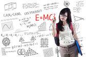 Female student writes formula — Stock Photo