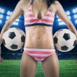 Sexy woman holding soccer balls at field — Stock Photo #45798639