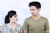 Angry couple close-up expression at apartment — Stock Photo