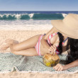 Sexy woman drinks a coconut water on beach — Stock Photo