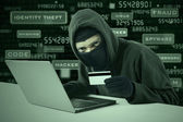 A hacker stealing online credit card — Stock Photo