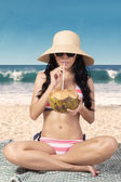 Sexy woman drinks coconut water — Stock Photo
