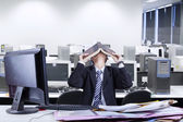 Stressful businessman covering his face — Stock Photo